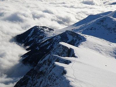 Nežilovo Crag (2,000-2,200 m) above clouds, Macedonia