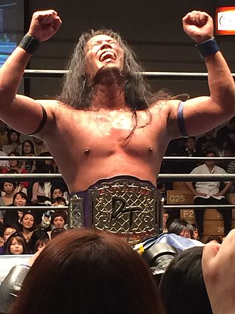 DDT Extreme Division Championship - Akito with the DDT Extreme Division Championship belt in September 2014