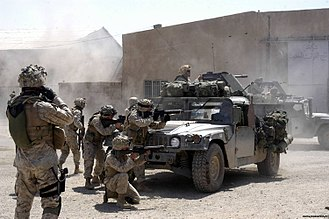 First Battle of Fallujah - U.S. Marines from 1st Battalion, 5th Marines fire at insurgent positions during the First Battle of Fallujah.
