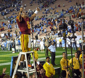 Mark Sanchez - Sanchez, holding the sword of the USC drum major, salutes the fans after a victory in his final regular season game at rival UCLA.