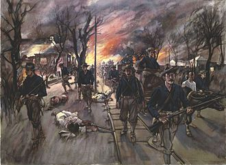 Caloocan - The ammunition train and reserves of the 20th Kansas Volunteers, Col. Frederick R. Funston, marching through Caloocan at night after the battle of February 10.