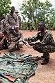 3rd Company, Beninese Army sergeant demonstrates AK-47 disassembly at Bembèrèkè 2009-06-12.JPG