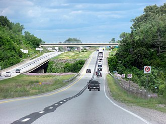 Ontario Highway 403 - Highway 403 eastbound at the Grand River bridge near Brantford. The stretch between Woodstock and Hamilton was rehabilitated in 2011, which included installing central guardrails and paved shoulders.