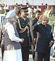 A.P.J. Abdul Kalam being welcomed by the Prime Minister, Dr. Manmohan Singh soon after the President's return from Singapore, Philippines and Republic of Republic of Korea, at Palam Technical Area in New Delhi on February 9, 2006.jpg