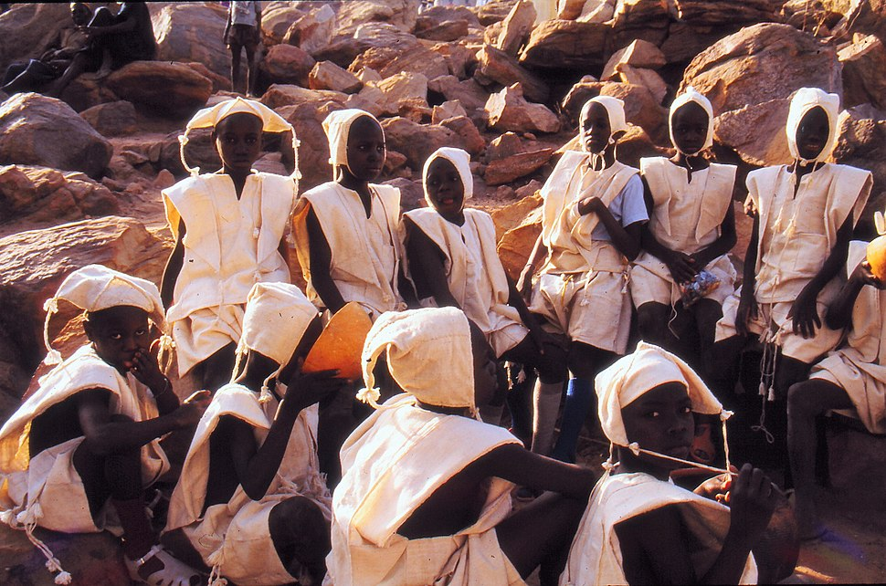 ASC Leiden - W.E.A. van Beek Collection - Dogon markets 39 - Eleven boys in white clothing with bonnets at Tireli market, just after circumcision, Mali 1990