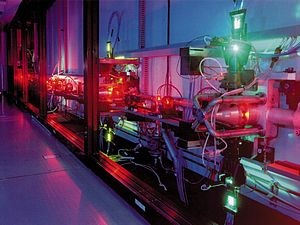 Atomic vapor laser isotope separation - An atomic vapor laser isotope separation experiment at LLNL. The green light is from a copper vapor pump laser used to pump a highly tuned dye laser which is producing the orange light.