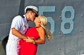 A Sailor kisses wife after deployment. (10461645543).jpg