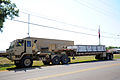 A U.S. Army M1088 tractor truck operated by Soldiers with the 565th Quartermaster Company moves off the road at the Indiana National Guard Armory in Scottsburg, Ind 120802-F-HS649-135.jpg