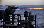 A U.S. Marine assigned to 26th Marine Expeditionary Unit (MEU), utilizes an observational optic to provide security aboard the USS Kearsarge (LHD 3) as it transits the Straits of Tiran towards Jordan, June 6 130606-M-SO289-001.jpg