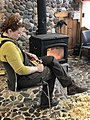 A Woodworker Whittling in Front of a Wood Stove.jpg