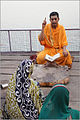 A brahmin priest reading a Hindu text near Ganges Varanasi.jpg