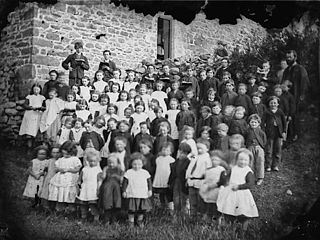 A group of children and young persons (a choir?)