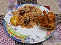 A home made plate of mutton biryani served with chicken kassa cooked in the bengali style.jpg