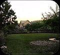 A neighborhood back garden showing circular flower bed (5242668250).jpg