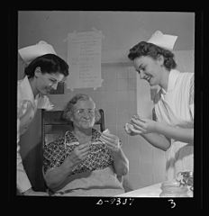 A student nurse right instructs a patient 8b08213v.jpg
