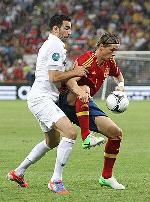Adil Rami - Rami challenging Spain's Fernando Torres at UEFA Euro 2012.
