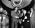 Adlai Stevenson and David Dubinsky shake hands on stage at an AFL convention, September 1952..jpg