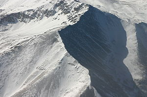 An aerial section of snow-covered Rocky Mounta...