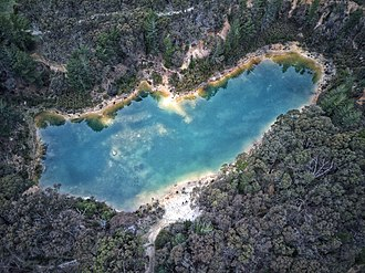Creswick, Victoria - The iridescent blue of Creswick's Blue Waters lake: a former open cut mine that has been converted into a bush camping and 4WD enthusiast playground. Shot: September 2018