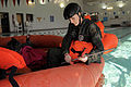 Airmen get a refresher in water survival training 150105-F-OF524-395.jpg