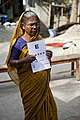 Akhtari Begum has her eyes tested in Koira village, Manikgunk village, Bangladesh. (10665799235).jpg