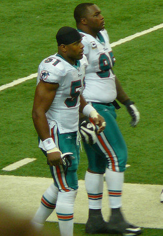 Akin Ayodele - Former Cowboys teammates Ayodele (left) and Jason Ferguson in Miami in 2009.
