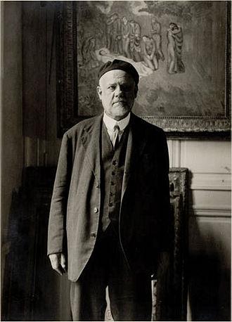 Ambroise Vollard - Ambroise Vollard, standing in front of Picasso's Evocación. El entierro de Casagemas
