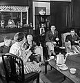 American officers take tea in a house in Winchester, Hampshire during 1944. D21564.jpg