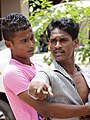 Angry Young Man and Restraining Friend - Negombo - Sri Lanka (14050212400).jpg