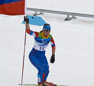 Para-Nordic skiing classification - Anna Burmistrova of Russia celebrating winning the gold medal during the Women's 3km Pursuit Standing Biathlon at the 2010 Vancouver Winter Paralympics
