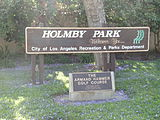 Sign of Holmby Park with a sign of the Armand Hammer Golf Course