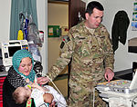 Army cardiologist examines Afghan boy with defect DVIDS517403.jpg