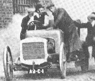 "Longbridge plant - ""Coming down the alley all aboard"" The first Austin, a 25-30, sets out for the Lickey Hills on its first trial run. Herbert Austin at the wheel. Saturday 7 April 1906"
