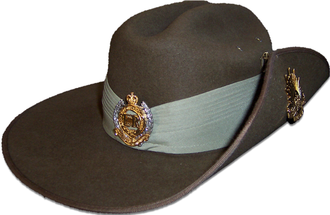 Rising Sun (badge) - Australian Army slouch hat, detailing the wearing of the Rising Sun badge on the upturned brim.