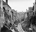 Az Ikva patak a Katolikus konvent átjáró felől az Ikvahíd utca felé nézve. Fortepan 1849.jpg