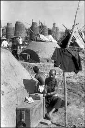 Backyard furnace - Workers tend backyard furnaces (1958)