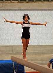 Young gymnast on the beam