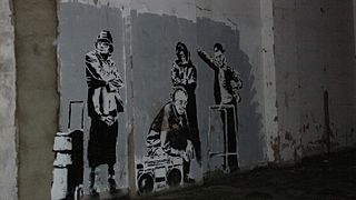 Banksy people Clerkenwell.jpg
