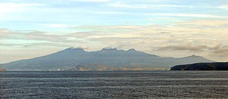 Mount Mariveles - Mount Mariveles with Mount Limay to its right as seen from the entrance of Manila Bay. The island in the foreground right is Corregidor.