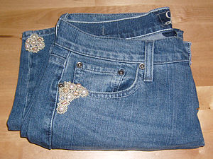 Bead embroidery - A pair of denim jeans embroidered with freshwater pearls and seed beads.
