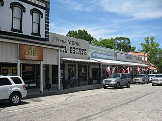 Bellville, Texas - Stores along Holland Street on the courthouse square