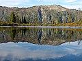 Bench Lake reflecting trees and ridge. (8ca50c8021174474bd10b65ecccd1bf0).JPG