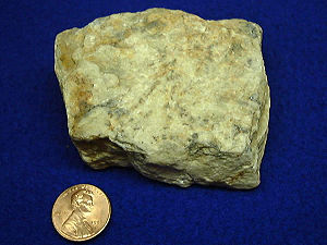 Beryllium - Beryllium ore with 1US¢ coin for scale