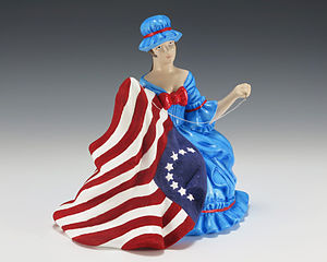 Gerald R. Ford Presidential Museum - Ceramic figurine of Betsy Ross sewing the American flag made to commemorate the American Bicentennial