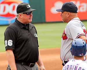 Bill Miller (umpire) - Miller (left) discusses a call during a 2014 game with Atlanta Braves manager Fredi Gonzalez