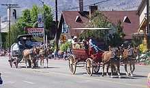 photo of two mule-drawn wagons in the Bishop Mule Days parade