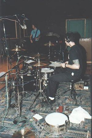 Adam Carson - Adam Carson in studio with Jade Puget (background) during the recording of Black Sails in the Sunset