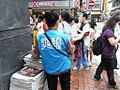 Blue uniform Sharp Newspaper distribution 2012 HK.jpg