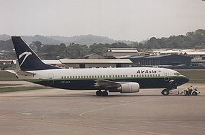 AirAsia - The historical Airasia colour scheme in the 1990s, donning under a blue and green cheatline with a white eagle logo. It was a full-service carrier before 2002. (image taken in 1999)