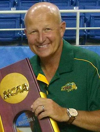 Craig Bohl - Bohl holding one of his FCS National Championship trophies in 2013.